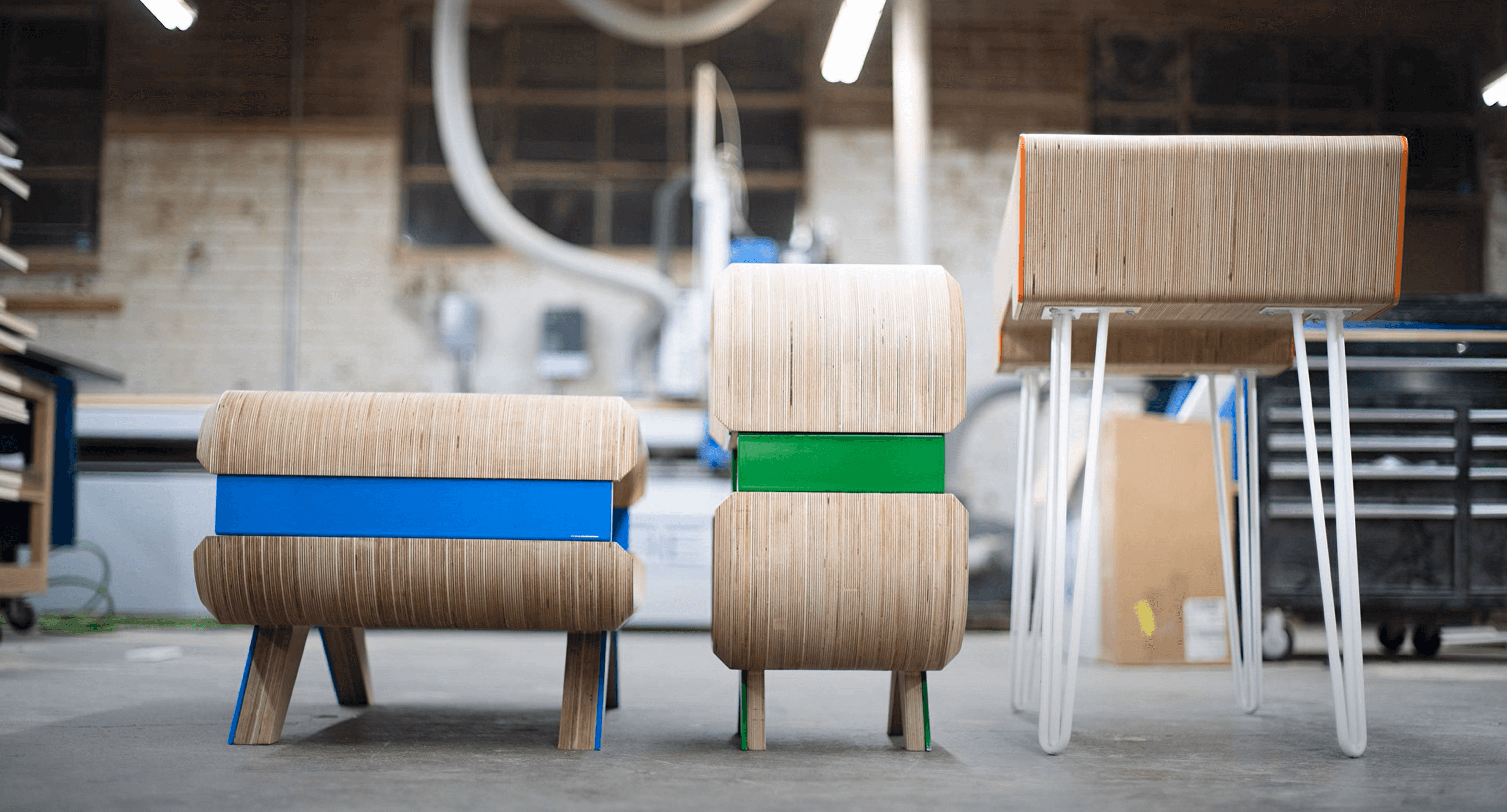 three pieces of wooden furniture in a woodshop
