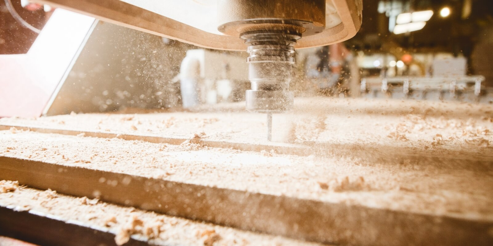 cnc router with wood chips flying around it